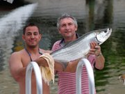 Dad and his first Tarpon 7-19-2003